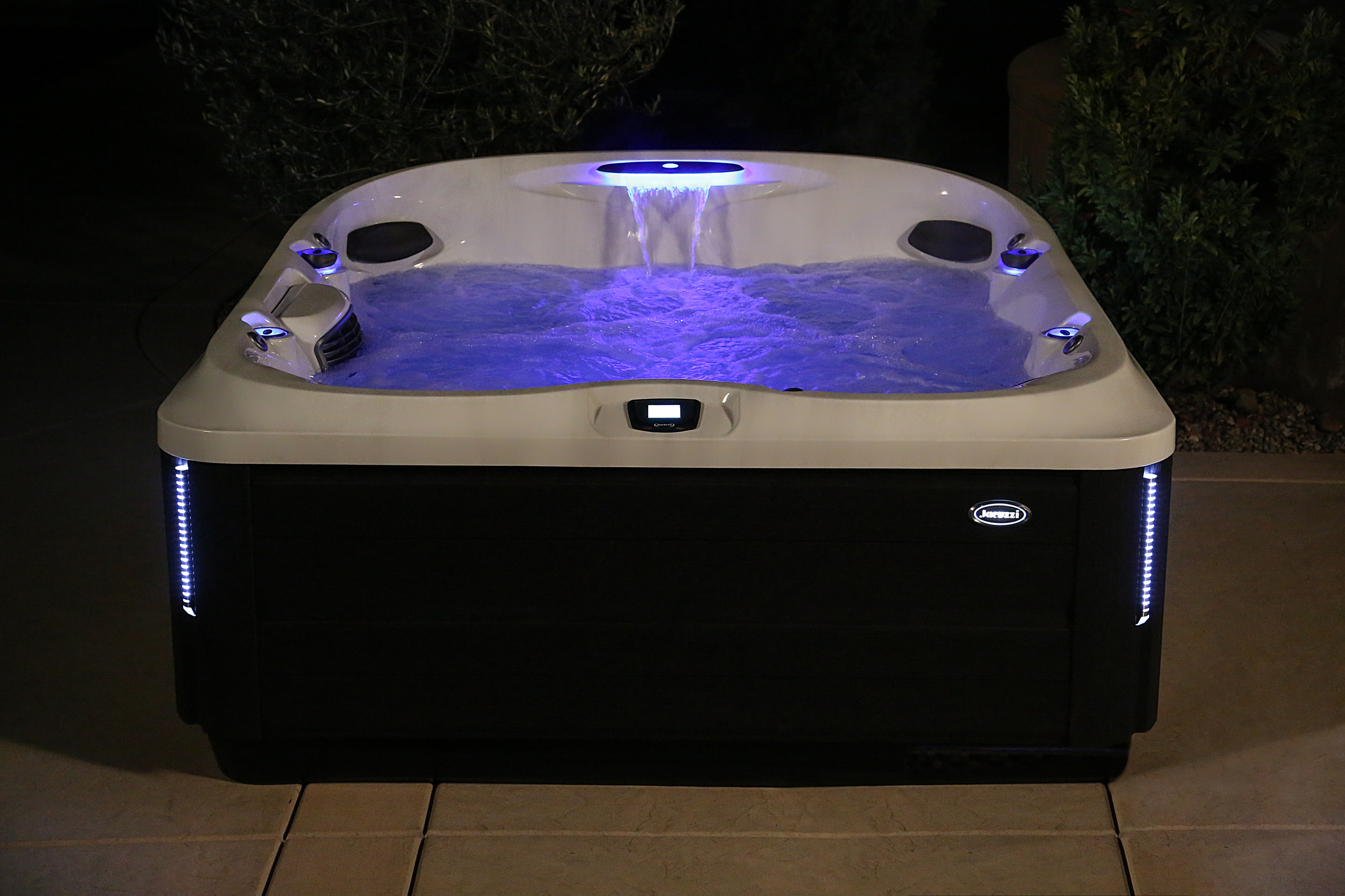 Outdoor Jacuzzi Hot Tub at night.